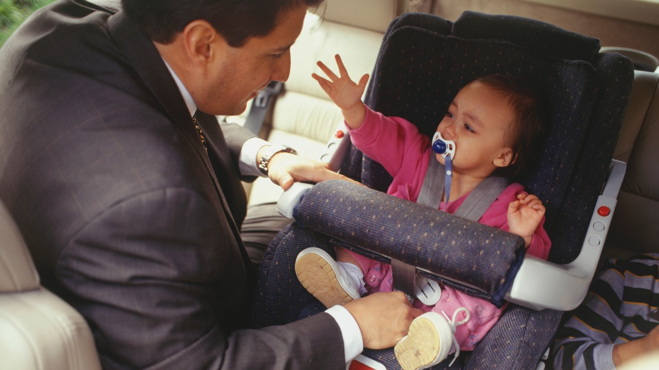 Father looking after child in van, elevated view