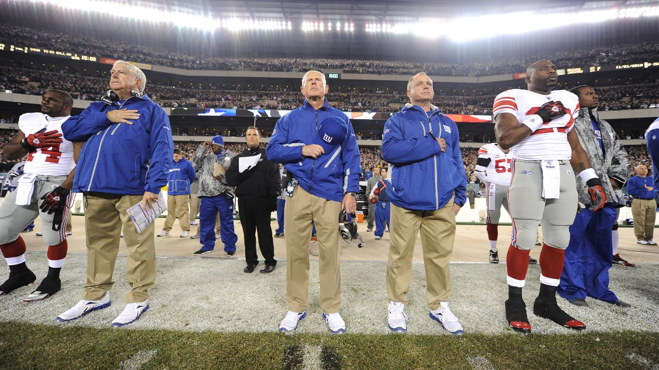 New York Giants head coach Tom Coughlin stands next to assistant coaches Mike Pope and Jerry Palmieri during the National Anthem before playing against the Philadelphia Eagles in a week 11 NFL football game at Lincoln Financial Field in Philadelphia, Pennsylvania on Sunday November 21, 2010 (AP Photo/Evan Pinkus)