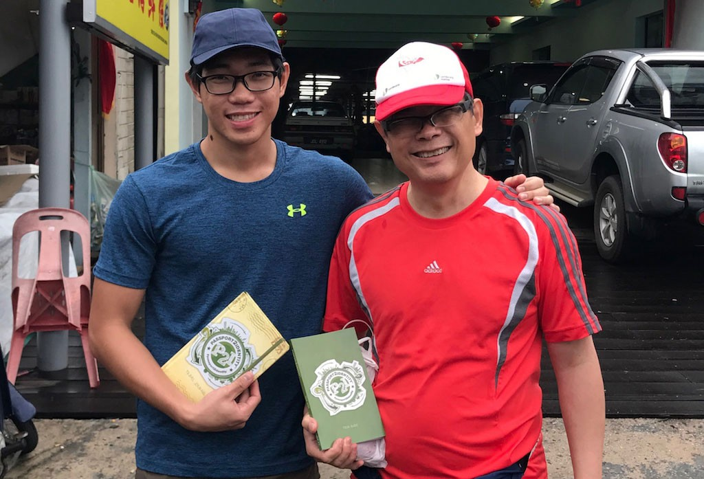Son and father holding Passport2Identiy material